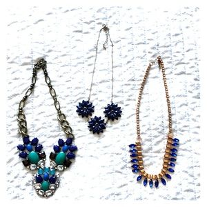 Set of 3 blue-toned statement necklaces.